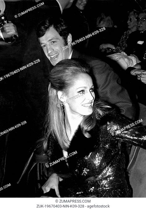 Apr. 3, 1967 - Paris, France - French actor JEAN-PAUL BELMONDO with URSULA ANDRESS during the opening night of 'The Thief of Paris'