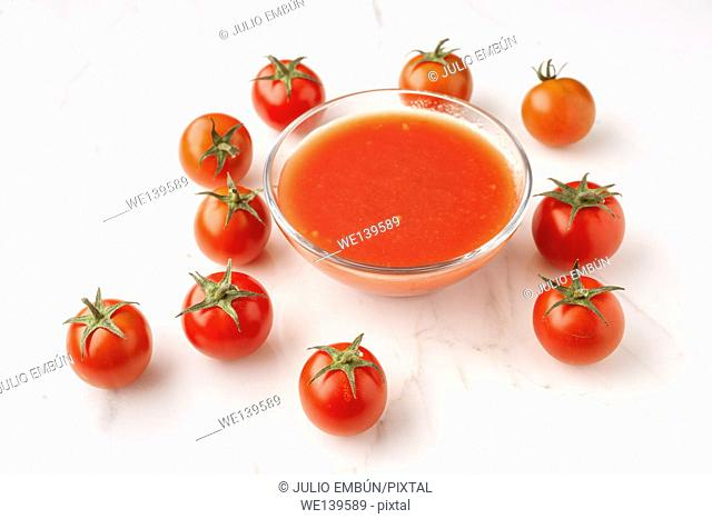 tomatoes and tomato sauce on elegant marble