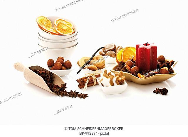 Christmas dainties, cinnammon star-shaped biscuits, cinnammon sticks, star anise, vanilla crescent shaped biscuits, gingerbread printen