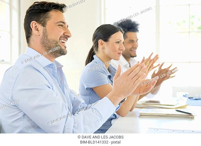 Business people applauding in conference room