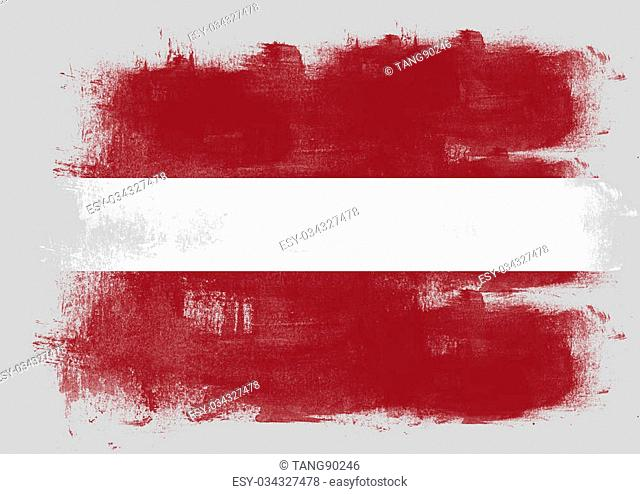 Flag of Latvia painted with brush on solid background
