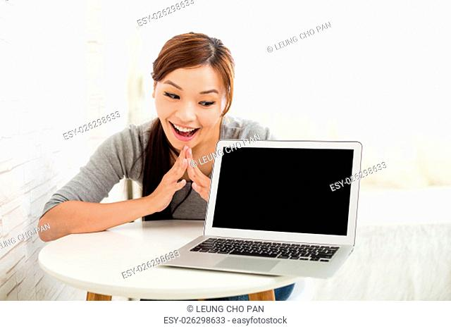 Woman showing blank screen of notebook computer