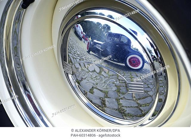 A 1932 Ford Hot Rod is reflected on a rim by the brand Ford at the 'Street Mag American Car Show'in Hanover,Germany, 25 July 2015
