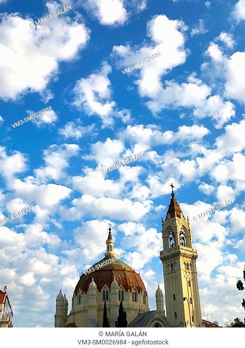 San Manuel y San Benito church over cloudy sky. Madrid, Spain