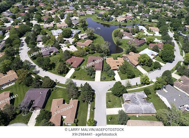 Aerial view of a neighborhood in suburban Chicago with a center pond. Northbrook, IL. USA