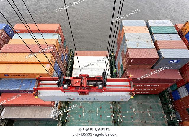 Container being loaded onto a ship, Hamburg, Germany