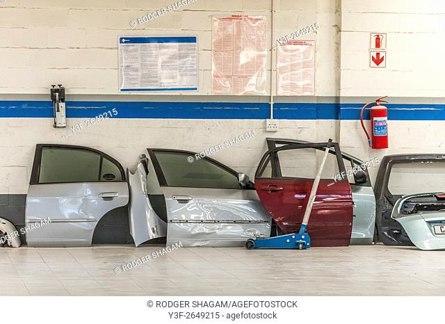 Old car doors, damaged and removed for replacement at a panel beater shop. Cape Town, South Africa