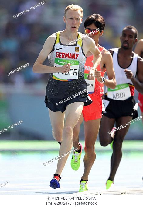 Richard Ringer (L) of Germany competes in Men's 5000m Round 1 heat of the Athletic, Track and Field events during the Rio 2016 Olympic Games at Olympic Stadium...