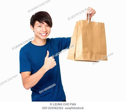 Man hold with shopping bag and thumb up
