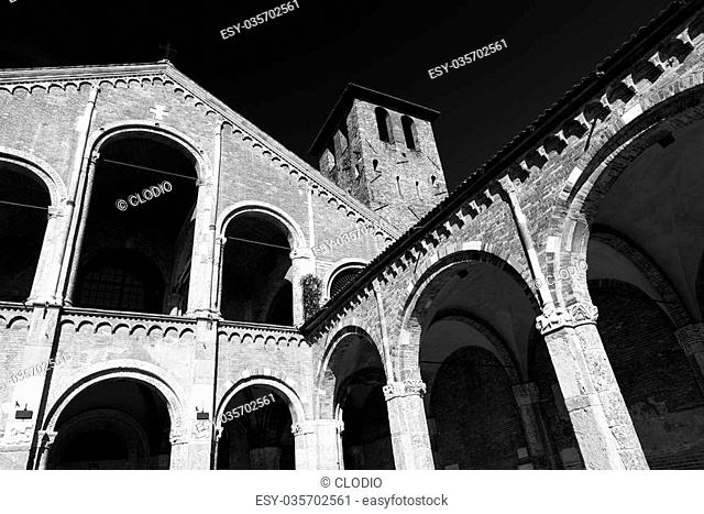 Milan (Lombardy, Italy): the medieval church of Sant'Ambrogio, in Romanesque style. Facade and portico. Black and white