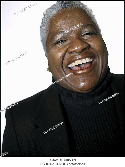 Portrait of middle aged African American woman laughing