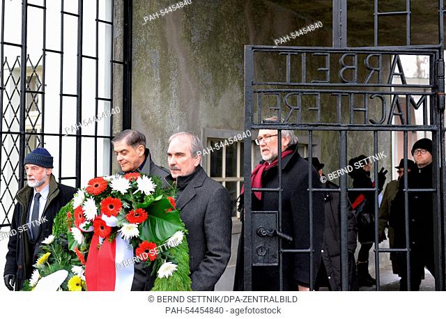 The chairman of the Central Council of German Sinti and Roma, Romani Rose (2-L) and Brandenburg State Secretary for Cultural Affairs Martin Gorholt (SPD