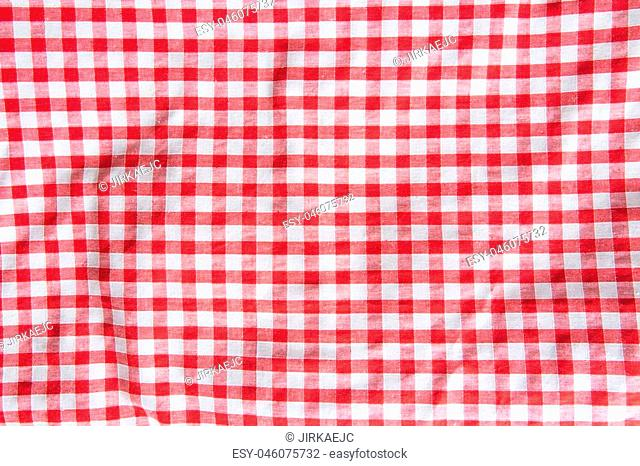The crumpled checkered tablecloth background. Top view