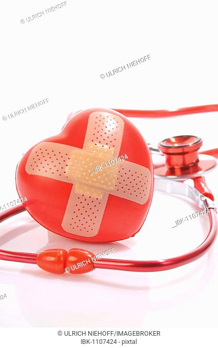 Heart with adhesive bandage and a stethoscope