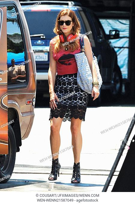 "Kate Walsh seen dancing around on the set of her show """"Bad Judge"""" filming in Encino Ca. The actress was seen wearing a black skirt and high heels with a..."