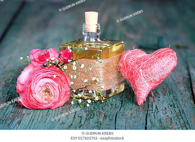 Still life with a fragrant gift on an old shabby wooden table for mothers day or valentines day