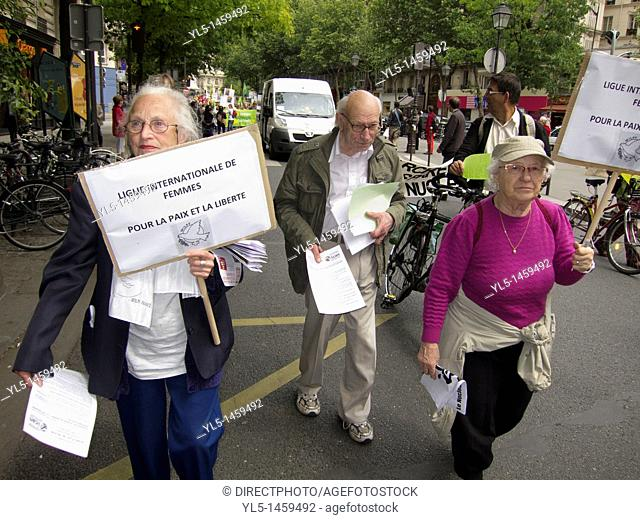Paris, France, Environmental Demonstration Against Nuclear Power, Seniors marching and Holding Signs