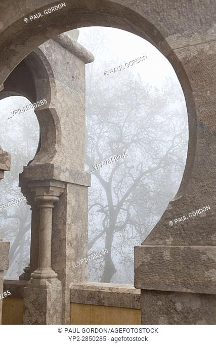 Sintra, Portugal: Horseshoe arch on a foggy morning at Pena Palace