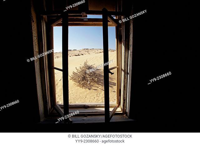 View through window in Kolmanskop Ghost Town - Luderitz, Namibia, Africa