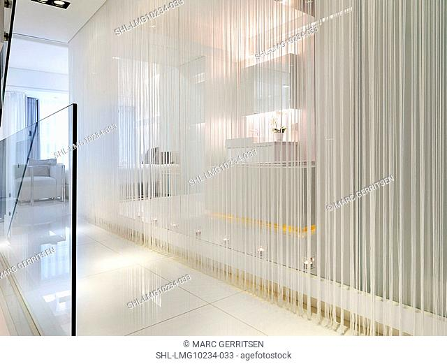 Hallway in modern home with string curtain