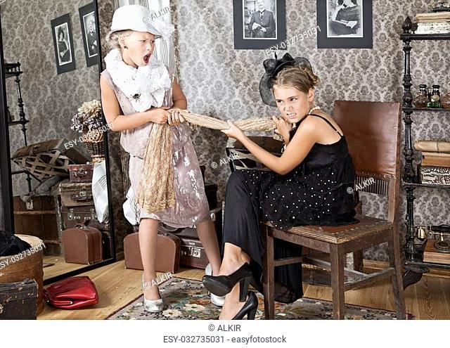 Two little girls are arguing for Grandma's dress
