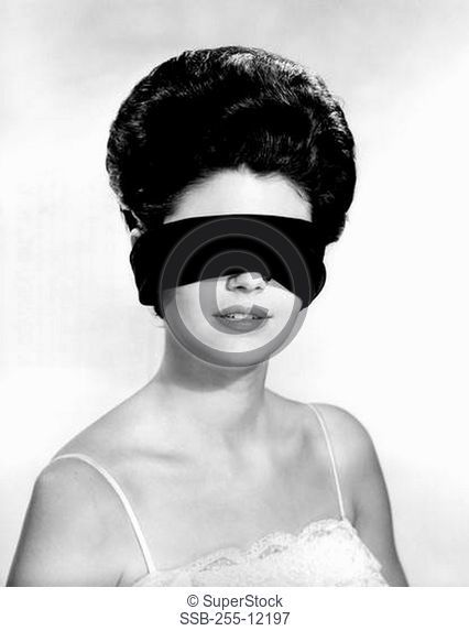 Young woman wearing blindfold