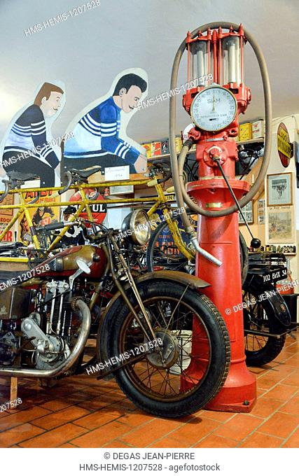 France, Herault, Boujan sur Libron, Chapy museum, exhibition of former motorcycles in the middle of posters of time, old gas pump with crank