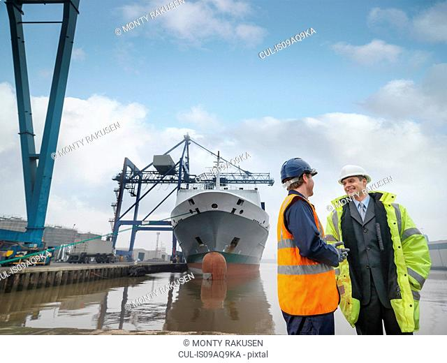 Businessman And Port Worker With Ship
