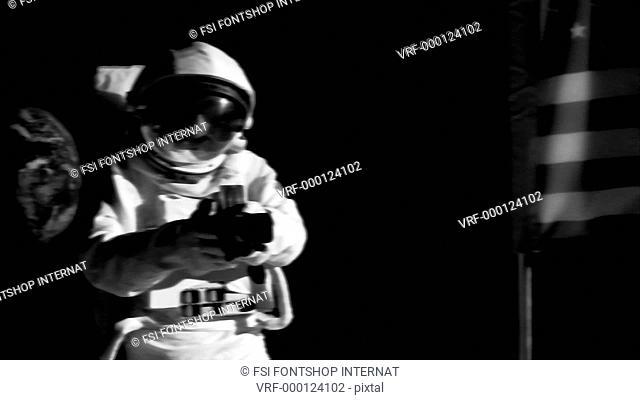 Shaky, MS, ZI, PAN astronaut using a vintage medium format camera