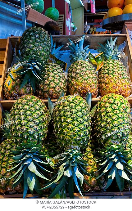 Pineapples in a fruit shop. San Miguel market, Madrid, Spain