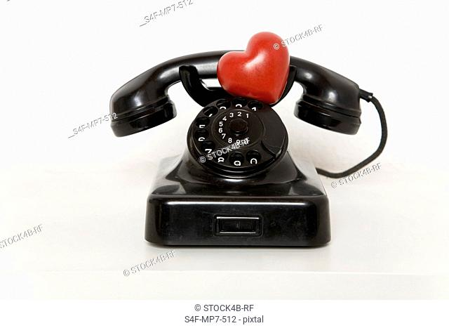 Heart on old-fashioned telephone