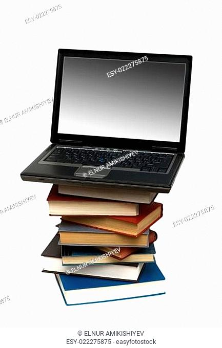 Concept illustrating evolution from books to computers