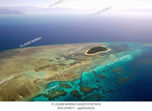 Aerial photography of coral reef formations of the Great Barrier reef near Cairns, North Queensland, Australia. the Unesco world heritage site is the world's...