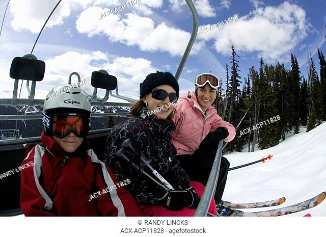A young family on a chairlift, Whistler Mountain, British Columbia, Canada