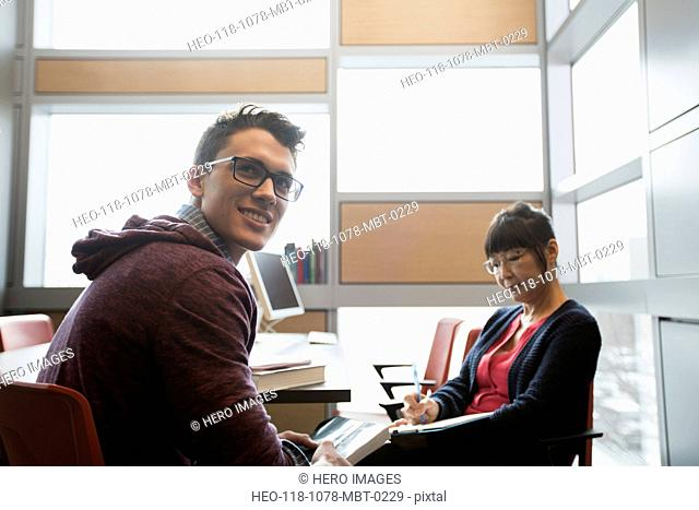 Professor and college student in office