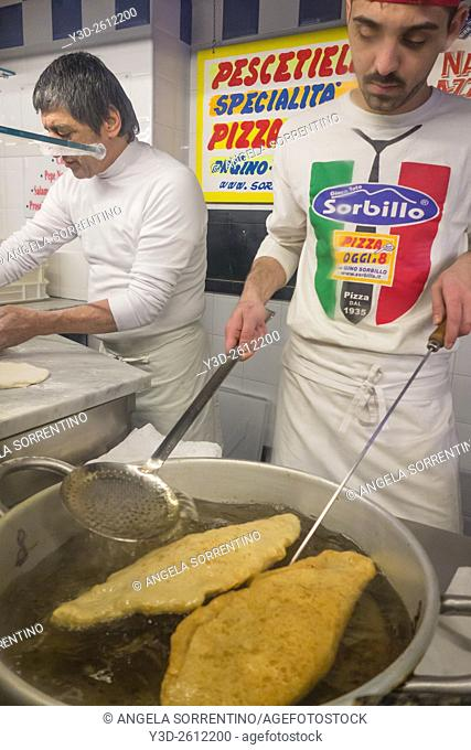 Chef making deep fried Pizza, street food in Naples, Italy