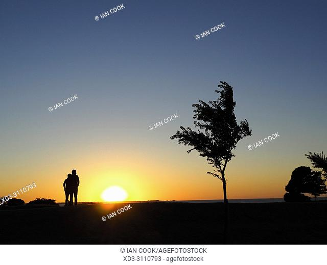 couple watching sunset, Saint-Martin-de-Re, Ile de Re, Charente-Maritime Department, Nouvelle Aquitaine, France