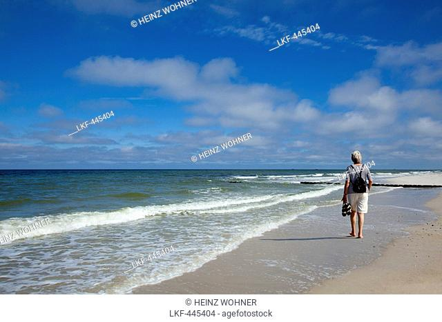 Woman walking along the beach, near Kampen, Sylt island, North Sea, North Friesland, Schleswig-Holstein, Germany