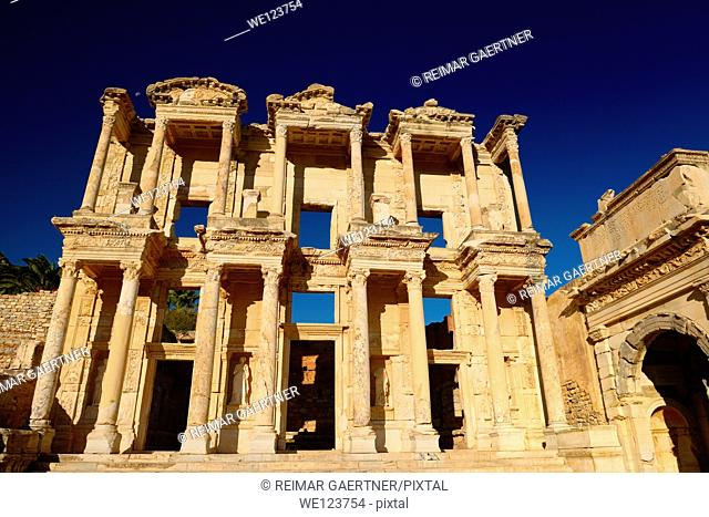 Ruins of the facade of the Library of Celsus and Mazaeus gate to the Agora of the ancient city of Ephesus Turkey