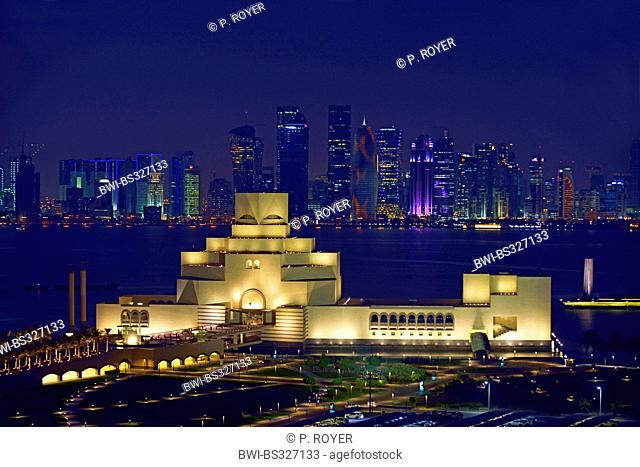 nightly panoramic view over the main city with the Doha Museum of Islamic Art in the foreground, Qatar, Doha