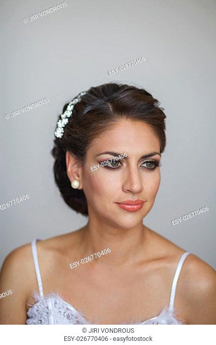 Portrait of Beautiful Bride in Wedding Dress and Decoration