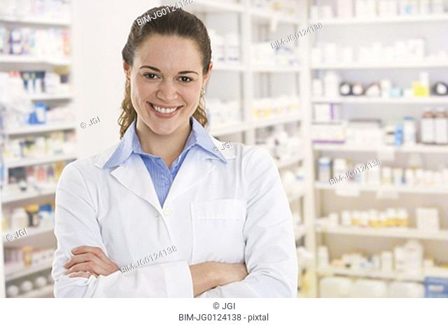 Hispanic female pharmacist smiling in pharmacy