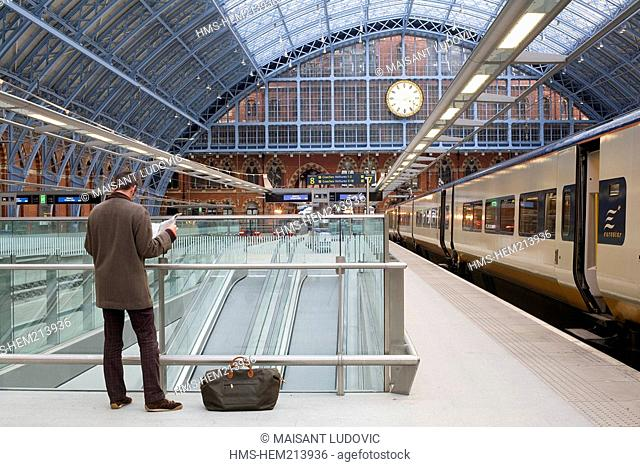 United Kingdom, London, St Pancras International train station, Eurostar with a traveller reading his newspaper