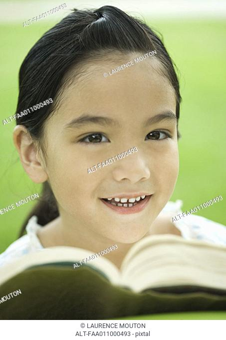 Girl with book, portrait