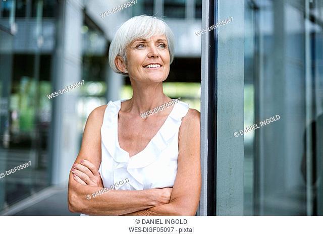 Portrait of smiling senior woman looking sideways