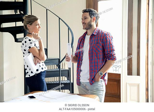 Wife and husband discussing home improvement plans
