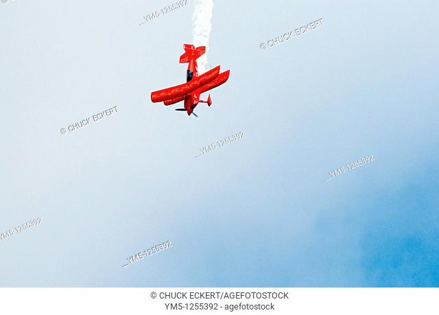 Red Oracle Bi-plane performing stunts at the Chicago Air and Water Show  Concept as in stocks or home prices diving lower