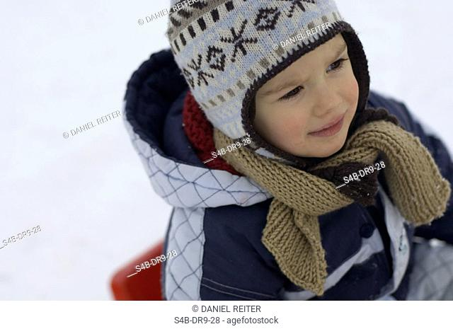 Young boy in warm winter clothes