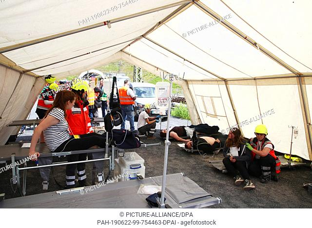"22 June 2019, Thuringia, Goldisthal: In a mobile treatment tent """"injured"""" are treated during an emergency exercise in the Fleckberg tunnel"