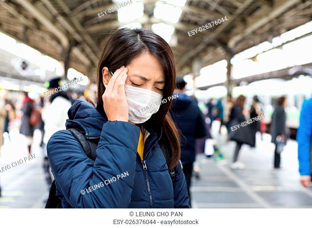 Woman feeling unwell in train station